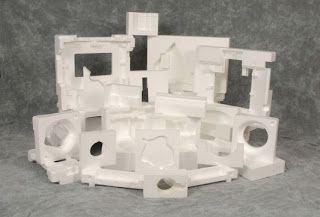 Polystyrene is a strong plastic created from erethylene and benzine that can be injected, extruded, or blow molded, making it a very useful and versatile manufacturing material.