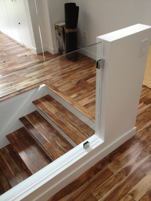 glass railings - make a cut out in the wall for it so you can see the stairs, opens the basement up more