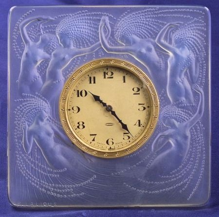 """Molded Glass """"Naiades"""" Desk Clock, Lalique, c. 1924, Marcilhac no. 264, the goldtone dial with Arabic numeral indicators, bezel with Greek key motif, within an oblong molded glass frame with pale blue iridescence, 4 1/2 in."""