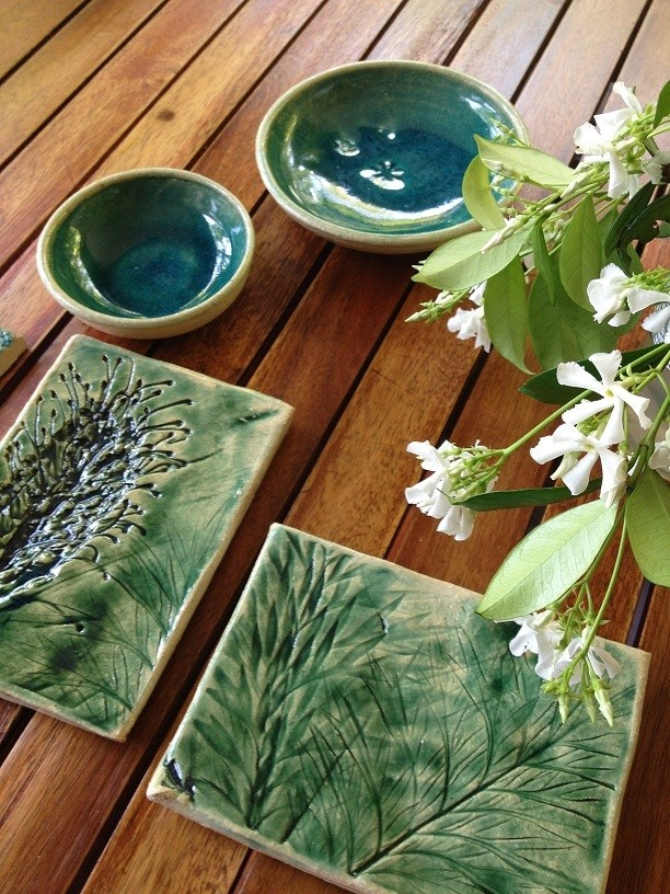 Green bowls and botany inspired tiles, with native australian plants.