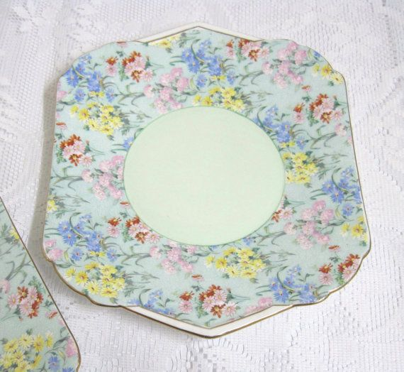 This is a very pretty cake plate from the Shelley Melody Chintz Range, with a pale green centre and Art Deco style white banded handles. The