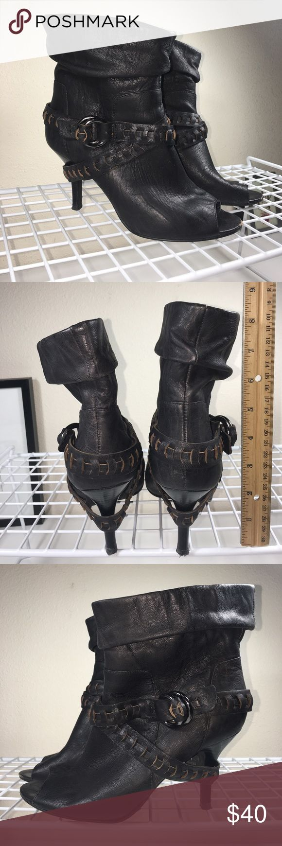 Guess Leather Booties With Braid Detail Sz. 6.5 Great condition leather heeled booties by Guess.  Footbed shows some discoloration due to wear but nothing major.  Heel caps show usual wear when walking on gravel or pavement.  No major scuffs, other than on the tips of the footbed (pictures), great condition and ready to ship!  Bundle to save.  Sorry, no trades.  Ask questions if any since all Poshmark sales are final.  I am not responsible for fit. Guess Shoes Ankle Boots & Booties