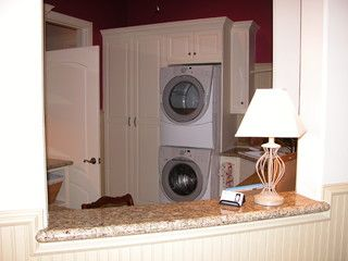 Custom cabinets and workspace for multi function laundry room.