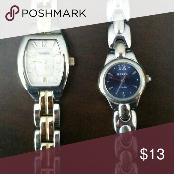 Ladies Fossil and Relic watches Two tone Fossil watch with white face, and silver Relic watch with blue face. The Relic has some discoloration on the band. Both need batteries. Fossil $8, Relic $5 Fossil Accessories Watches