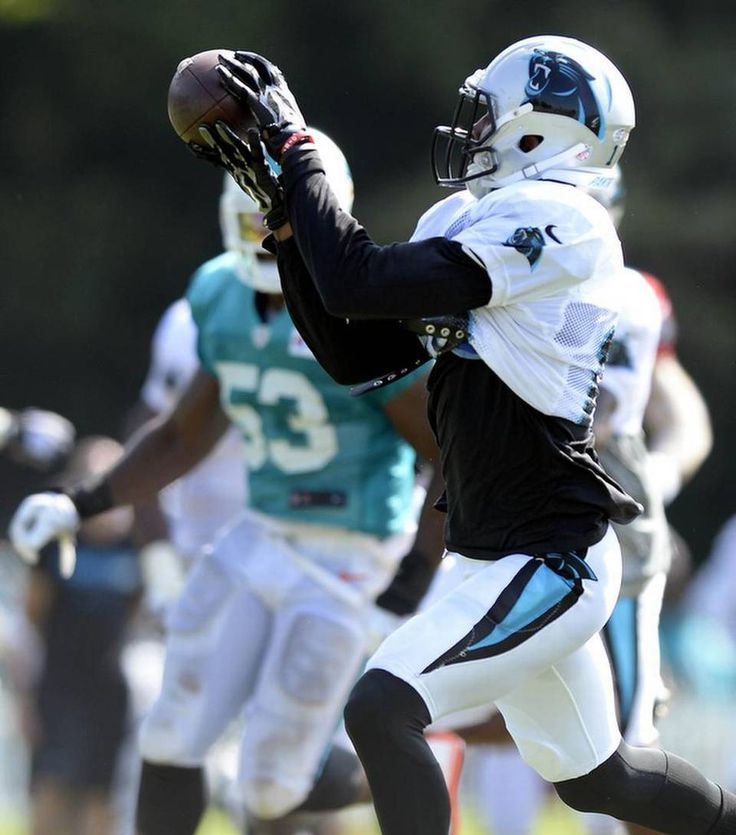 Carolina Panthers' Corey Brown (16) makes a reception past the Miami Dolphins defense during a scrimmage at the Carolina Panthers Training Camp at Wofford College in Spartanburg, SC on Wednesday, August 19, 2015.