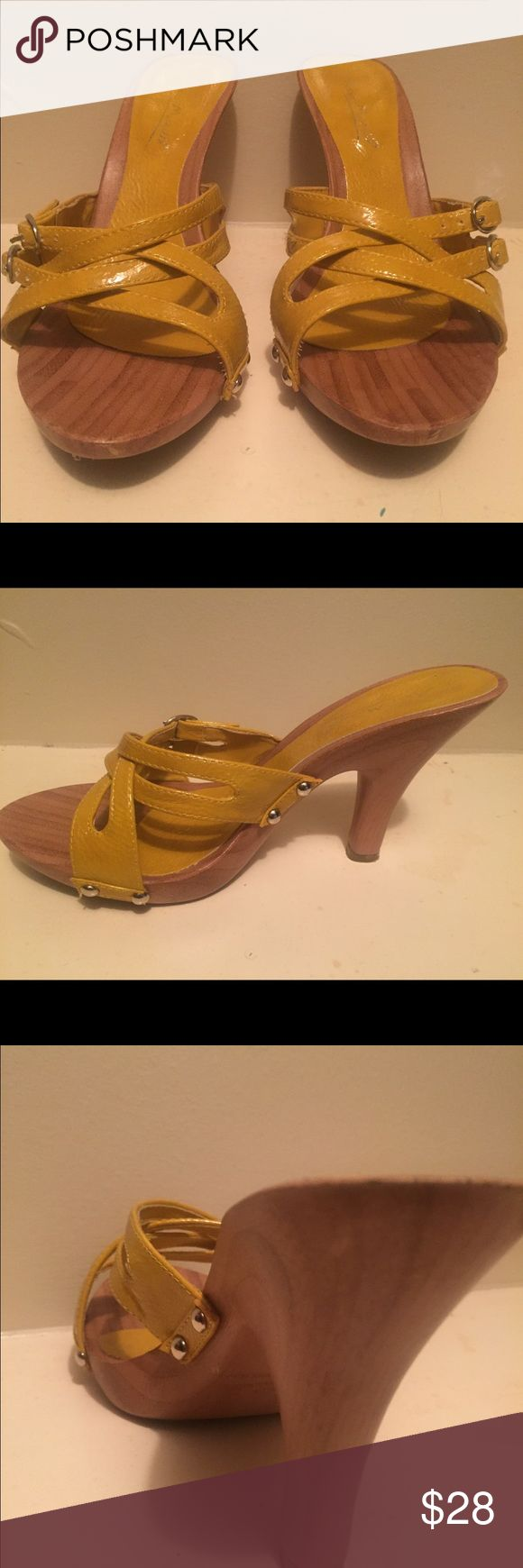 Yellow strappy heels... mustard yellow Wooden heel. In good used condition. Anne Michelle Shoes Heels
