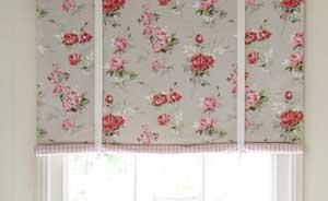 Simple self roll up fabric blind that ties up with ribbon. Looks fairly easy and pretty.