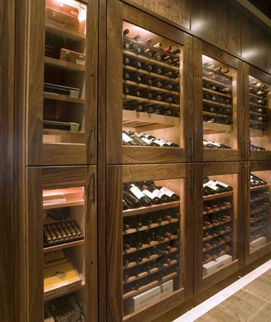 The stunning black walnut wine cabinets and electronic humidor adorn the dining room within the Bokx 109 restaurant at the Hotel Indigo in Newton, MA. The remote mounted,  ducted climate control provides dual-zone temperature control to ensure wine is stored at the perfect temperature. The electronic cigar humidor displays up to 50 boxes  of fine cigars and is humidified by the Vigilant digital Guardian system for a perfect smoke every time.