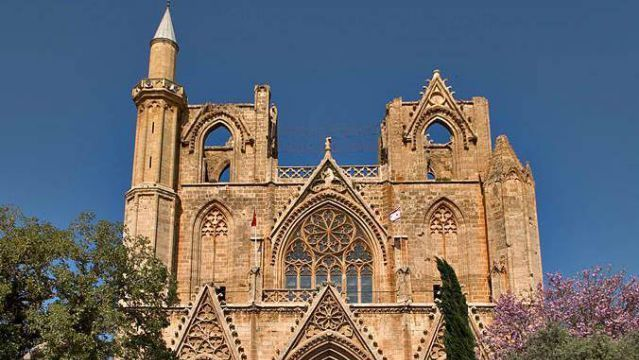 St. Nicolas Cathedral, Famagusta, Cyprus. The 13th century cathedral is a classic example of the French Gothic architectural style. It is the largest medieval building in Famagusta. Its Gothic architecture resembles the great cathedral of Rheims in Paris, France. The city is still illegally occupied by Turkish troops since 1974