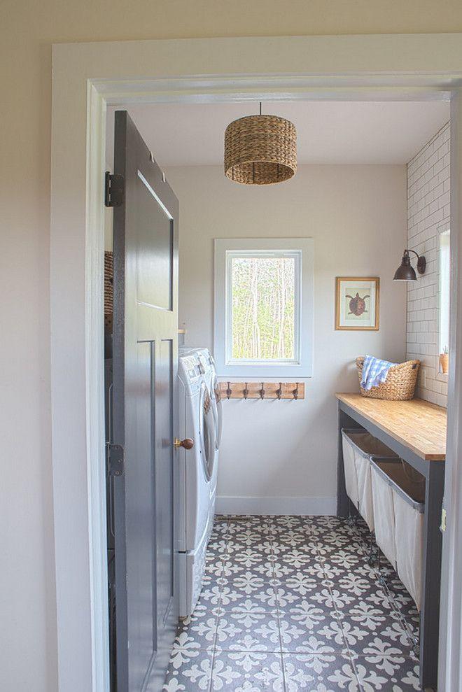 Farmhouse laundry room with grey interior door, grey custom folding doors and cement floor tile. Grey interior door paint color is Blackened by Farrow and Ball #BlackenedbyFarrowandBall Sharon Barrett Interiors