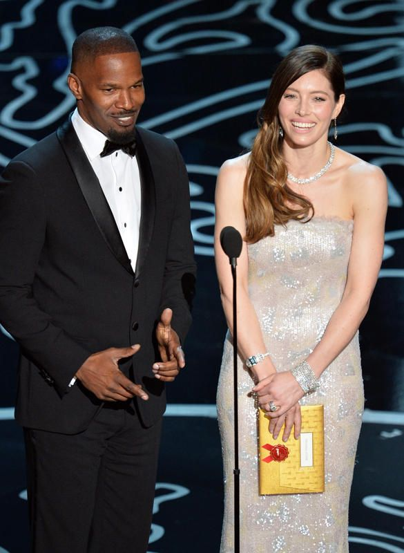 Jamie Foxx and Jessica Biel speak onstage during the 86th Annual Academy Awards at the Dolby Theatre in Hollywood on March 2, 2014. (Kevin Winter/Getty Images)