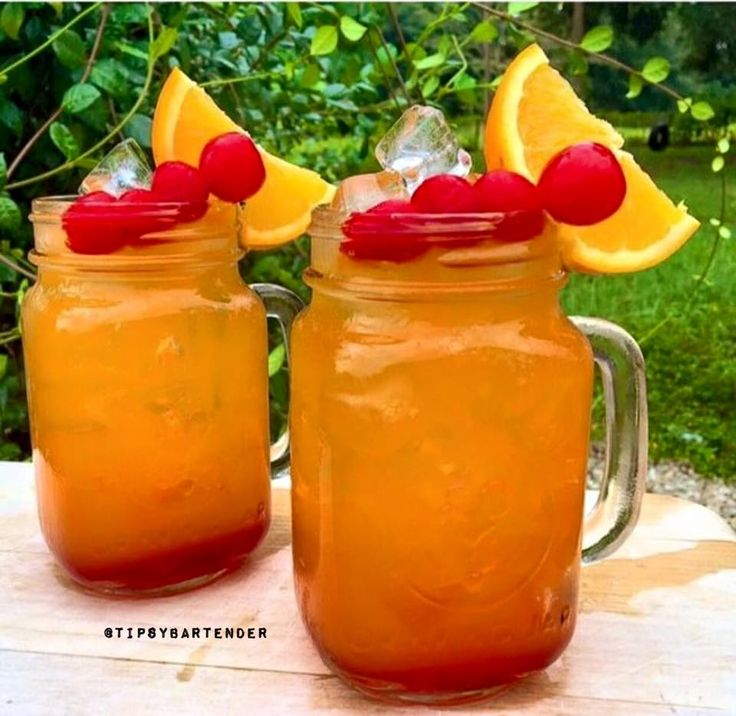 Passion Rum Punch Cocktail - For more delicious recipes and drinks, visit us here: www.tipsybartender.com
