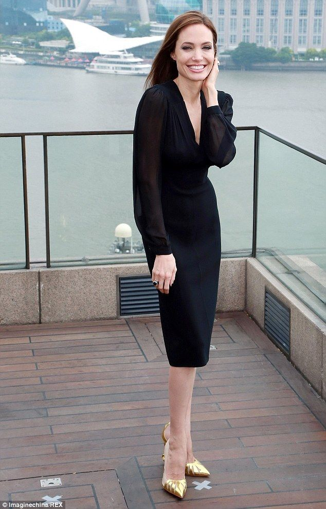 That's Shoe-business! Angelina Jolie promotes hit film Maleficent in Shanghai wearing THOSE famous Christian Louboutin heels and a black Michael Kors Gossamer dress. Read more: http://www.dailymail.co.uk/tvshowbiz/article-2647131/Angelina-Jolie-promotes-hit-film-Maleficent-Shanghai-wearing-THOSE-famous-shoes.html#ixzz3NG7it8tl