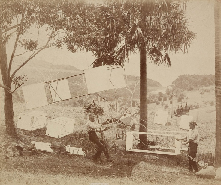 November 12, 1894: Australian researcher Lawrence Hargrave links together 4 box kites, adds a simple seat, and flies to altitude of 16 feet in the device. Photo by C. Bayliss, Source: State Library New South Wales