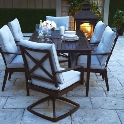 Lanterns and flowers bring an outdoor patio space to classic comfort