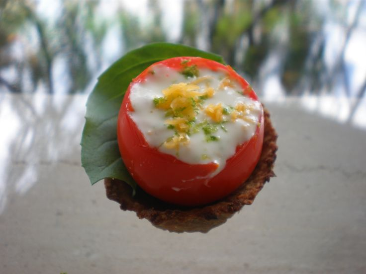 Cherry tomato filled with cheesy lime yogurt in a meaty muffin. . .
