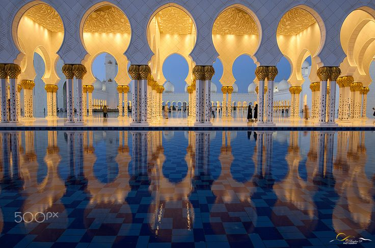 Arches and mirrors - Abu Dhabi mosque architectural details and the water element that transforms all the perspectives.