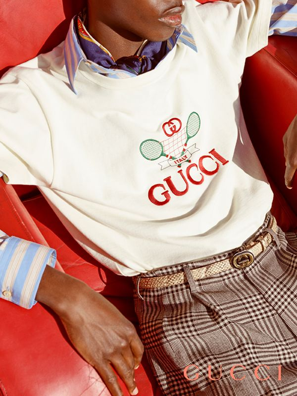 ca98287c830064 An archival motif, the Gucci Tennis embroidery embellishes an oversize  men's T-shirt.
