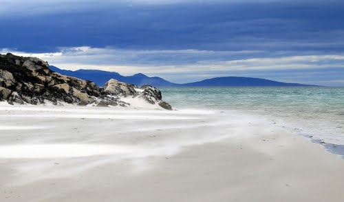 "The stunning, ""Silver Sands of Morar, looking towards the Island of Rum, Scotland. In general the beauty of the beaches in the Scottish Highlands is a well kept secret, ensuring privacy for visitors to the long stretches of clean, silvery sands......"