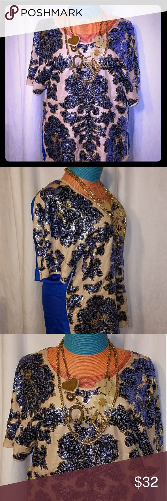 GORGEOUS short sleeved Neiman Marcus NWT. Royal blue satin back. On the front is a cream with stitched royal blue sequined flowers. The flowers are then lined with creamish-gold sequins. Rounded neckline. (Necklaces not for sale and do not come with shirt) Neiman Marcus Tops Blouses