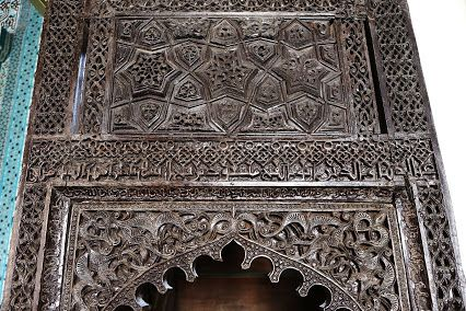 The minbar of Alauddin Mosque of Konya, dated in 1155 AD. The ebony minbar is dominated with kufic inscription and foliate floral-arabesque inside a square cartouche.