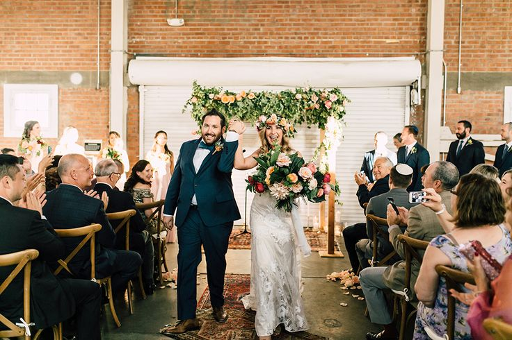 bridal recessional - photo by Plum and Oak Photo http://ruffledblog.com/a-must-see-industrial-wedding-with-gorgeous-florals