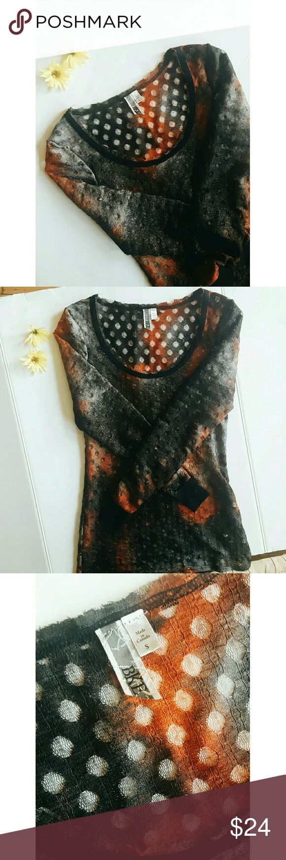 """BKE black and orange long sleeve top Brand BKE  Tag size Small  Materials 98% polyester 2%spandex  Bust 16.5""""  Length 26""""  Sleeves 25.5""""  Gently used - in like new condition   -Ships same day or next  -Smoke and pet free home  -Sorry I don't do tryons -No holds or trades  -Always open to reasonable offers -Happy to answer any more questions:) BKE Tops Tees - Long Sleeve"""