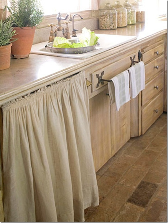 CHARMING  Beige and tan is homey and warm.  Cabinet curtain reduces the use of hardwoods used to make cabinet doors.