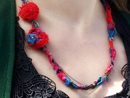 Statement Necklace - Bright, Beautiful Mess Reclaimed fabric and chain, vintage button for closure.  https://cherryberry.felt.co.nz