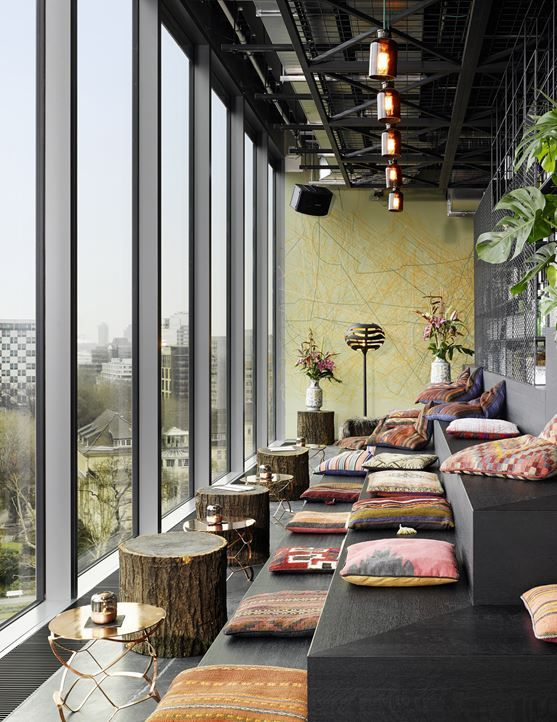 View full picture gallery of 25hours Hotel Bikini Berlin - tiered lounge seating with a view - cushions - timber coffee tables - beautiful - office inspiration