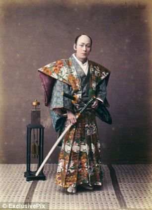 #Samurai clutching katana. The Samurai was the highest social caste until it was abolished as part of the Meiji reforms in the late 19th century