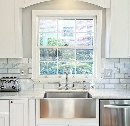 love the stainless farm sink, marble subway tiles, gray walls, white shaker cabinets