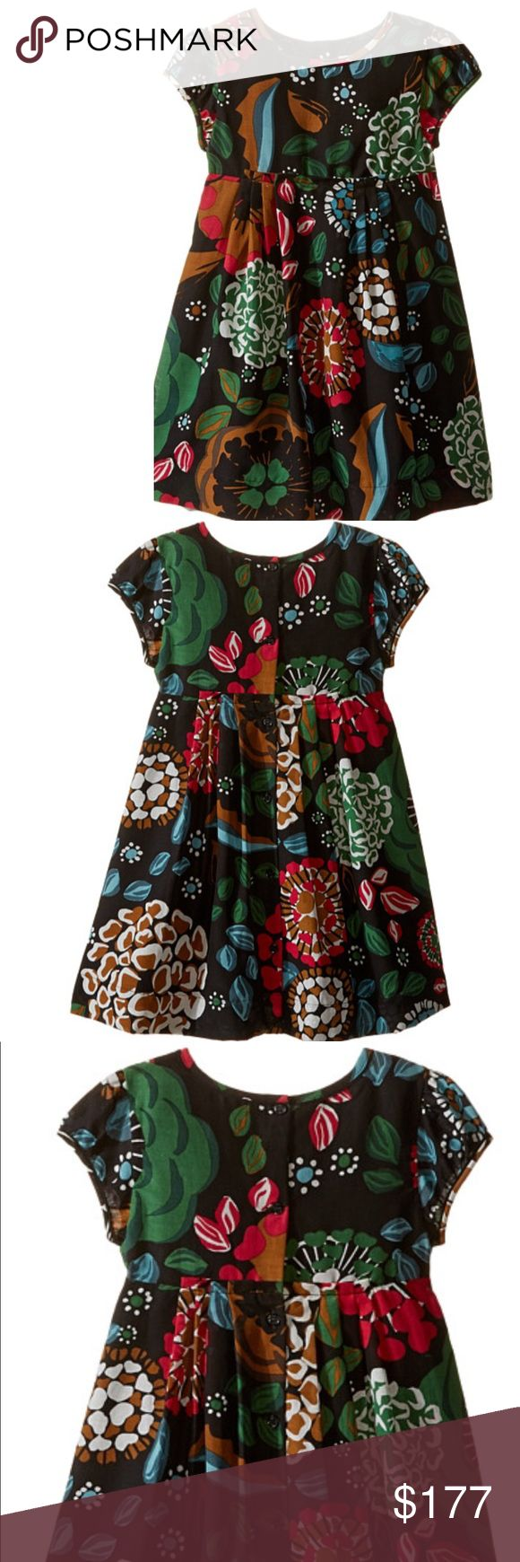 BurberryMini Wendi Floral Short Sleeve Dress.NWOT Burberry Short Sleeve Dress. Has button down all the way the back . Has lining skirt underneath. Has Pleats  gather Panel on middle front. Has short sleeves with a 1/4 in trim around arm hole . Length is 19 1/2 inches . Underarm to underarm is 11. 1/4 inches . 62%cotton, 38% silk z. burberry childrens Dresses