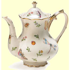 Lovely teapot...I see a bumble bee and a butterfly and a dragon fly