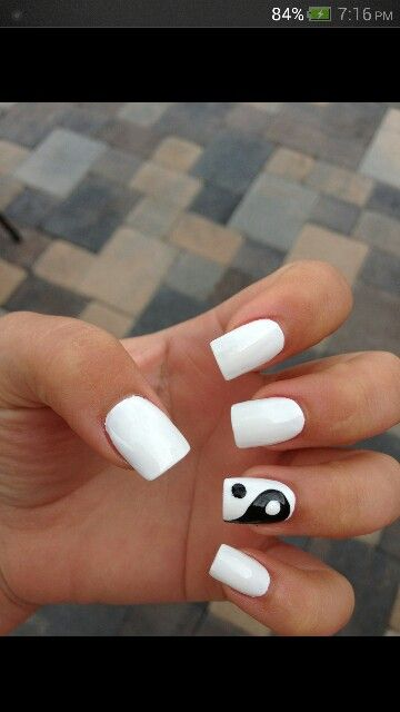 Simple white acrylic square nails with ying yang accent nail