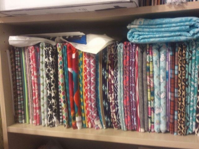 the Jocole blog: Fabric Organization ... this shows how to fold fabric so if will fit on a shelf
