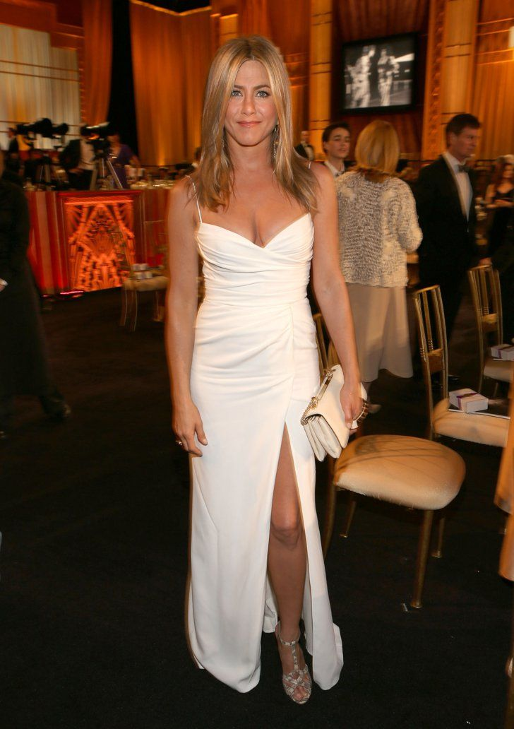 Pin for Later: 28 Style Lessons You'll Thank Jennifer Aniston For You don't have to be getting married to slip into a chic white gown . . .