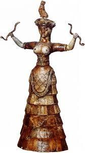 Dea dei serpenti, ca 1700-1600 a.C. Ceramica a tutto tondo, altezza 34,5 cm. Dal Palazzo di Cnosso. Iráklion, Museo Archeologico.