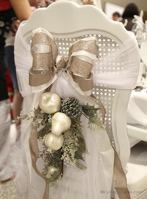 Christmas DIY Holiday Chair ~ Turn your dinning room chairs into fabulous decorations with a few yards of tulle fabric, ribbon, pretty flowers and glittered fruit.  Very pretty to put on the wedding couple's chairs.: