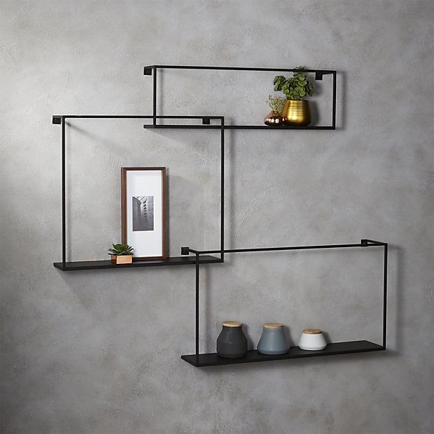 Shop 3-piece floating large matte black shelf set.   Sculptural industrial set composes geometric gallery in raw iron.
