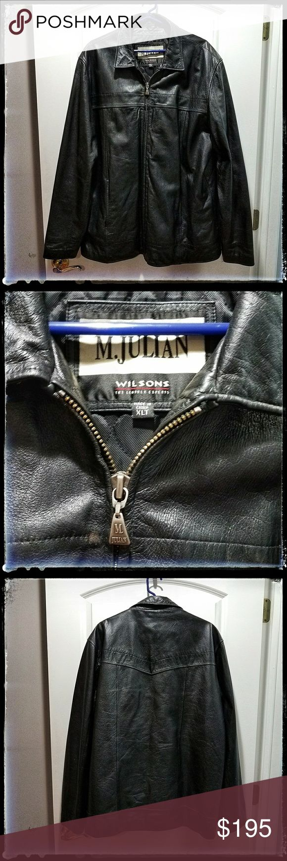 M. Julian Wilsons Big&Tall Black Leather Jacket EUC: Genuine leather Wilsons- M. Julian black formal type labeled for men with a zip front, straight bottom, two front pockets, and two inside secure pockets (cell phone compartment and a zippered slide pocket). In fantastic condition with no holes or tears. Size: XLT Please note: there is a small mark by the left elbow area. See pictures. Wilsons Leather Jackets & Coats