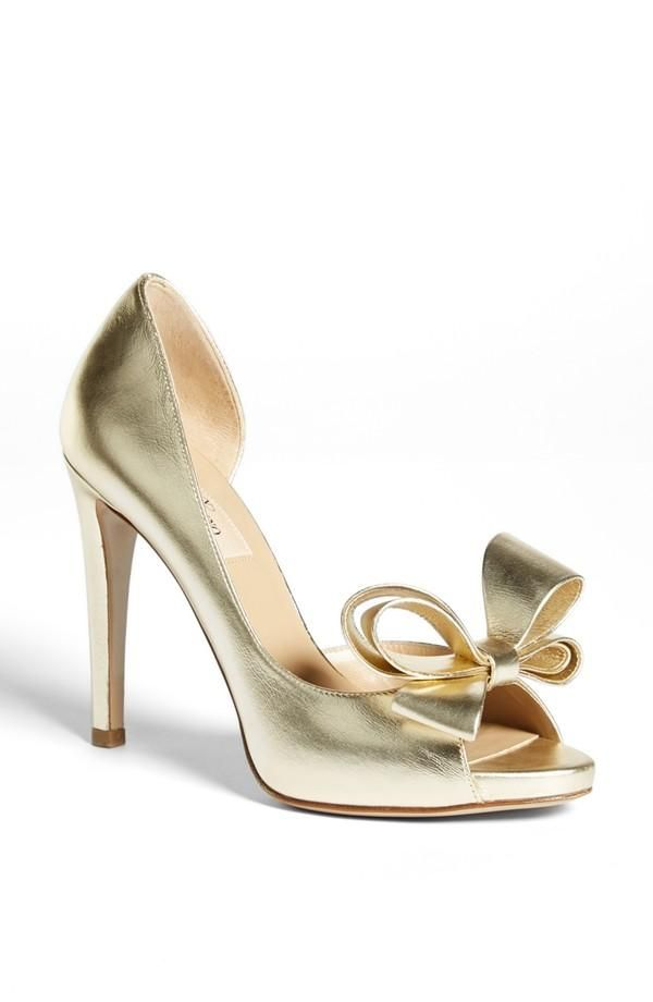 Valentino Metallic Gold Bow Pump  Now I'm very particular about a Gold heel. Not many people can pill it off and win me. This did ( ;