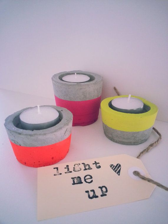 Concrete candle holders painted with neon