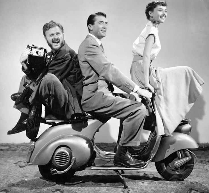 Eddie Albert, Gregory Peck and Audrey Hepburn photographed in a publicity still for Roman Holiday