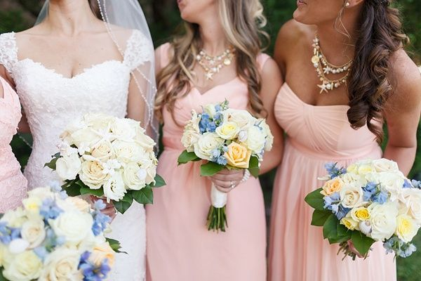 Blush bridesmaid gowns and coastal statement necklaces
