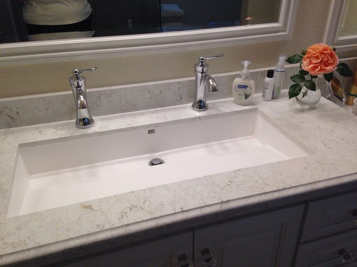Master bathroom - 'Wymara 2' trough sink by mti, installed as undermount. Moen 'Wynford' faucets in chrome.  Silestone 'LUSSO' countertop  http://m.mtibaths.com/products/sinks/vessel-semi-recessed/MTCS-713/view-specs