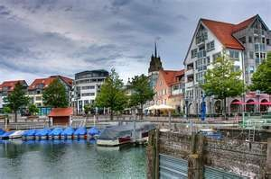 Friedrichshafen, Germany, on Lake Constance (Bodensee)... sit on the shores in Friedrichshafen and look across the Lake to Switzerland with the Alps in the distance.  My son used to work here, enjoyed those visits.