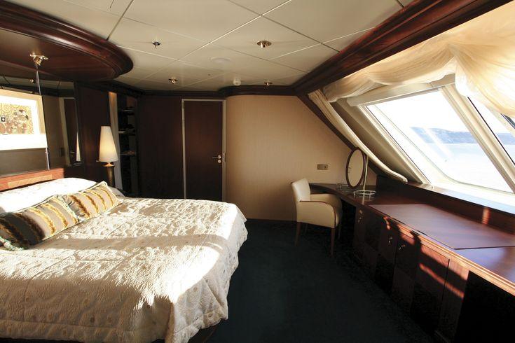 Schlafzimmer mit Doppelbett in der Owner's Suite.