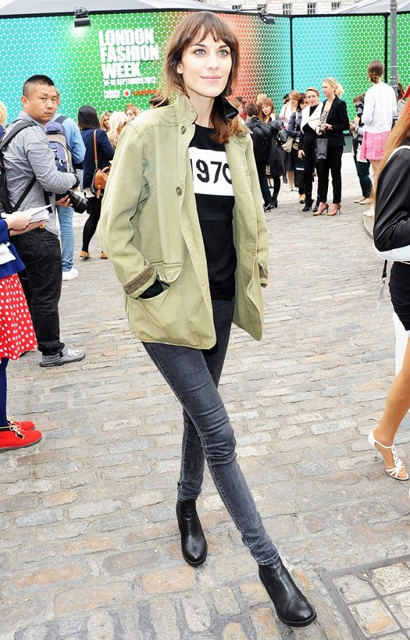 Alexa Chung wears a Bella Freud '1970' sweater, army jacket, gray skinny jeans, and black Chelsea boots: