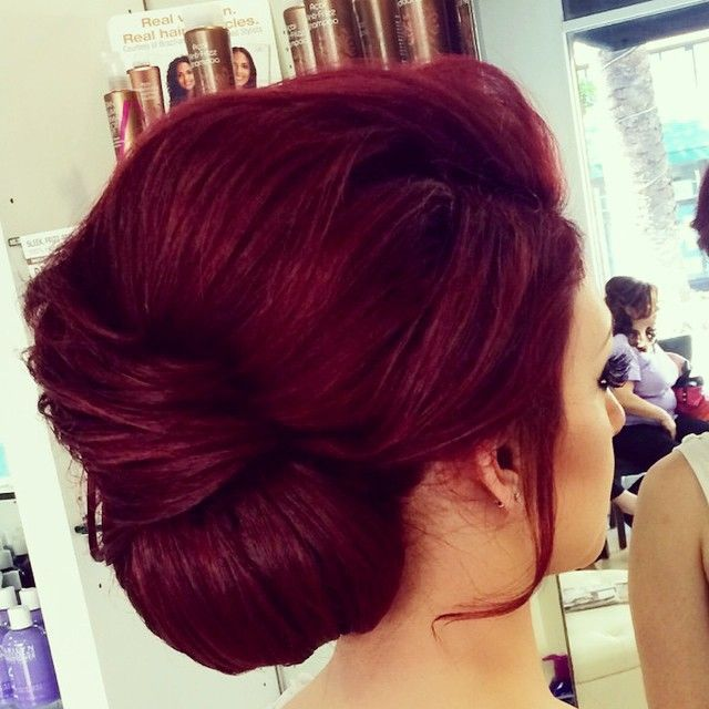Stunning hair colour with a beautiful tucked up do.
